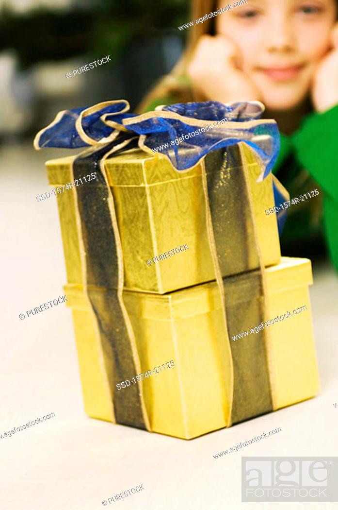Stock Photo: Girl looking at Christmas presents.