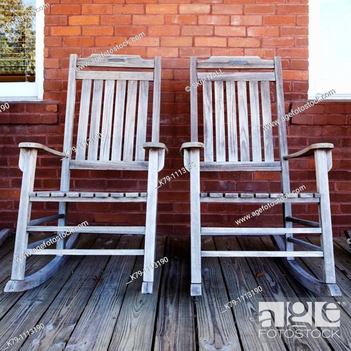Stock Photo: Two old rocking chairs on porch.