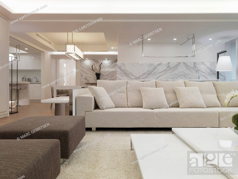 Stock Photo: Modern living room with white sectional sofa.