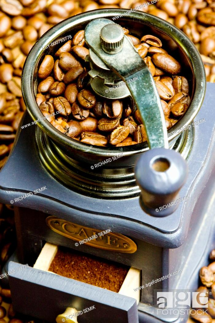 Stock Photo: coffee mill with coffee beans.