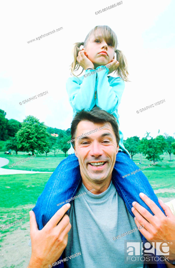 Stock Photo: Portrait of a father carrying daughter on his shoulders.