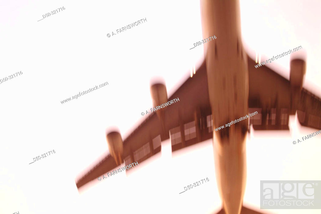 Stock Photo: JFK airport: jet flying overhead, coming in to land. New York, USA.