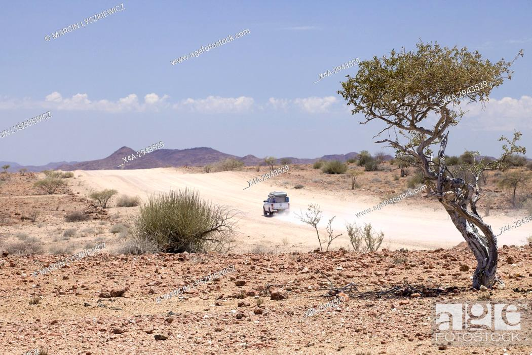 Stock Photo: A car on a clay road near Solitaire, Namibia.