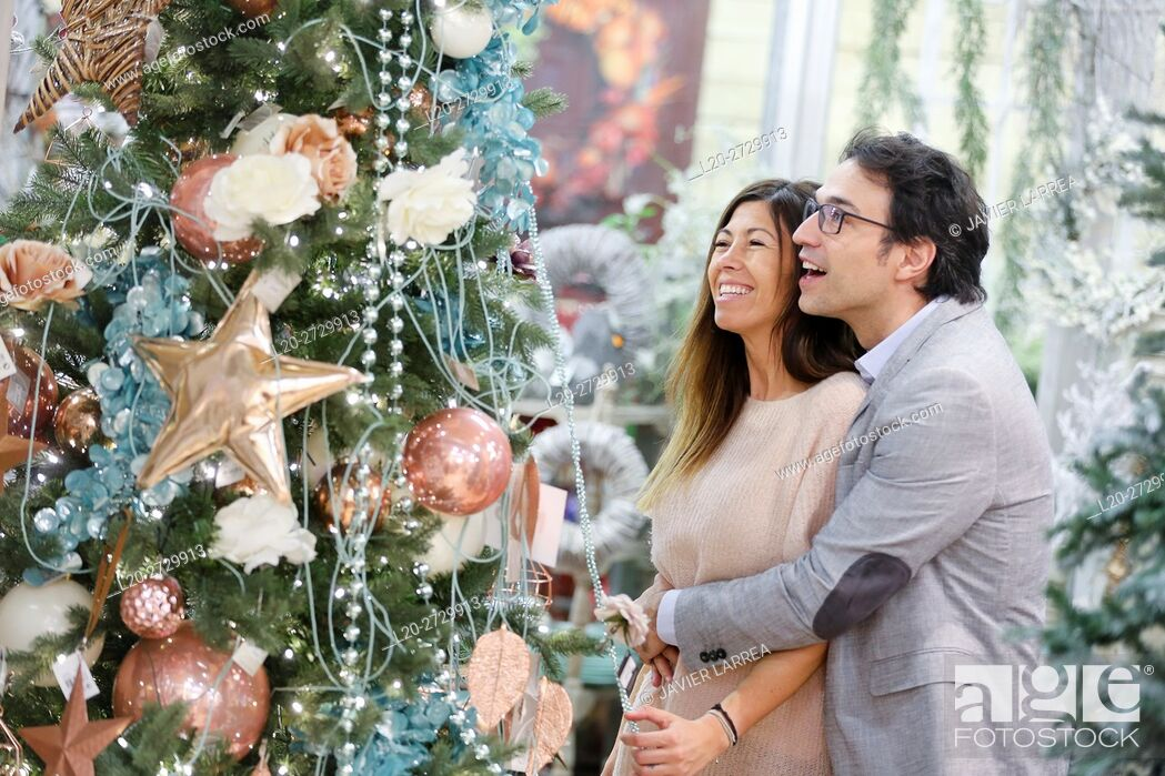 Stock Photo: Couple buying Christmas ornaments in garden center.