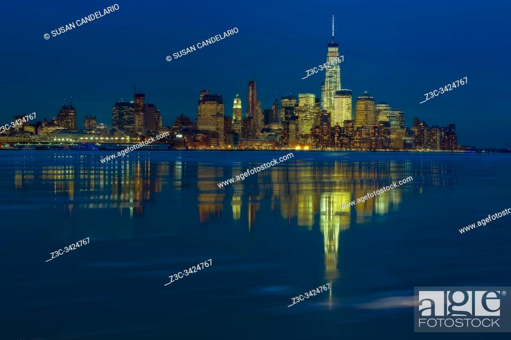 Stock Photo: Frozen Lower Manhattan NYC - The Hudson River is partially frozen on a clear but very chilly winter evening.