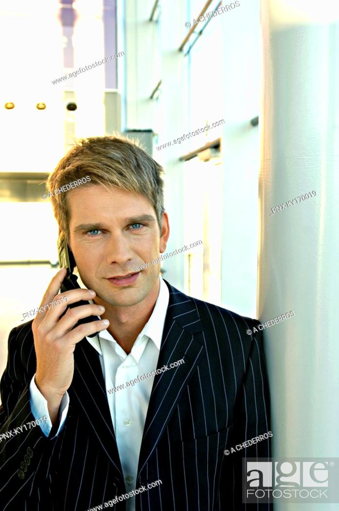 Stock Photo: Portrait of a businessman talking on a mobile phone.
