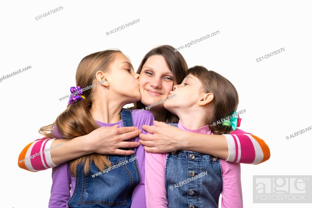 Stock Photo: Children joyfully kiss mom, isolated on white background.