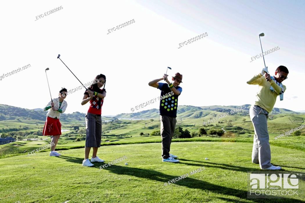 Stock Photo: View of people golfing on a pleasant day.