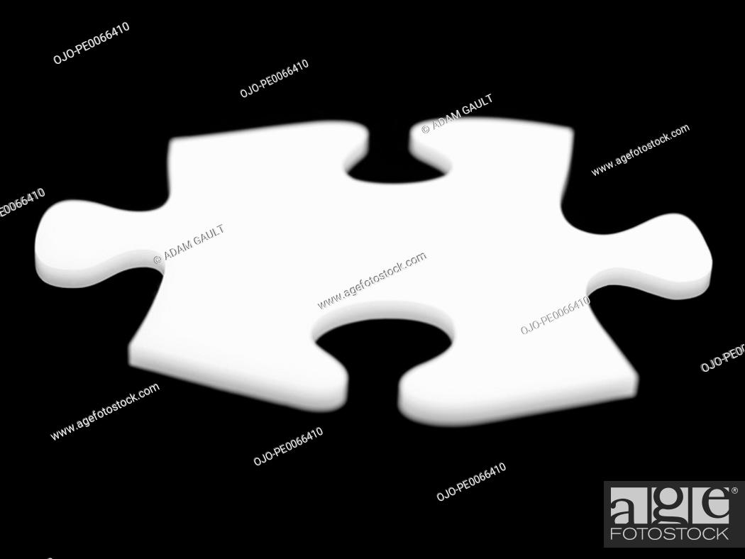 Stock Photo: Close up of single puzzle piece.