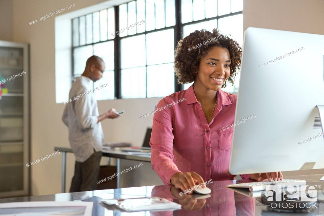 Stock Photo: Businesswoman using computer in office.
