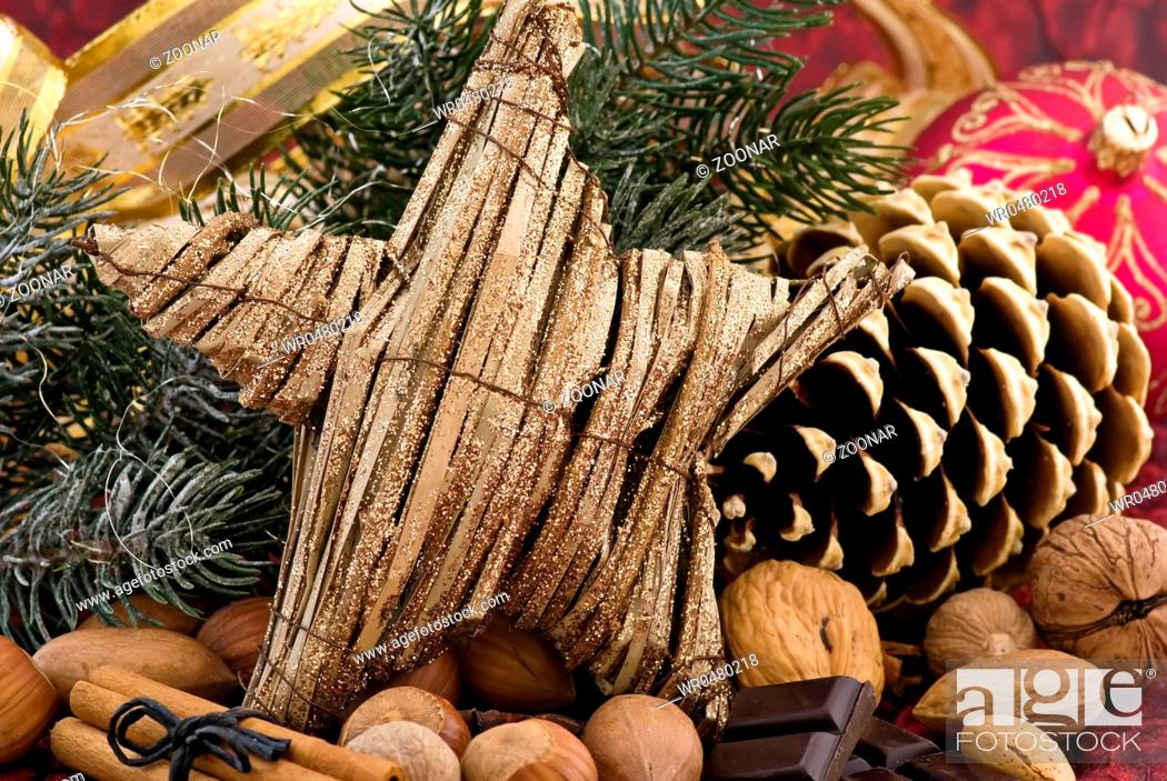 Stock Photo: Christmas decoration with a star and pine cone as closeup.