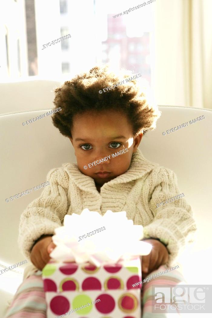 Stock Photo: African American child with birthday present.