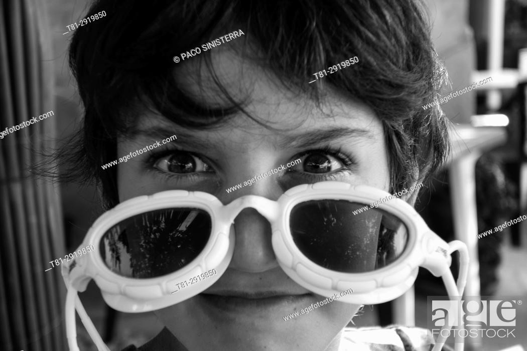 Stock Photo: Boy with diving goggles, Barcelona, Spain.