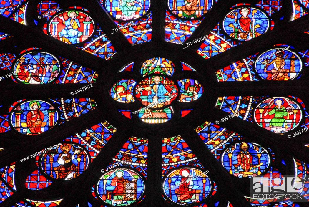 Stock Photo: stained windows at the Notre Dame, Paris.