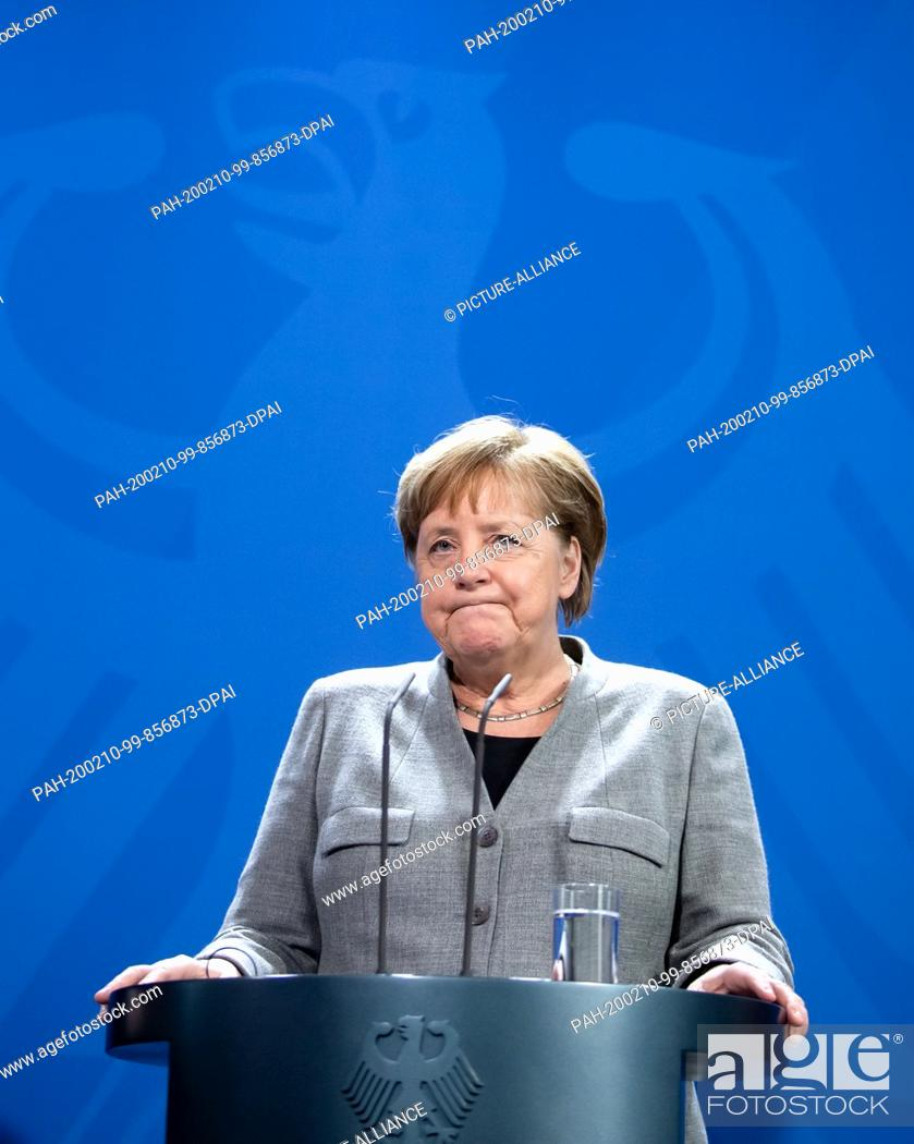 Stock Photo: 10 February 2020, Berlin: Federal Chancellor Angela Merkel (CDU) reacts to the resignation of CDU chairwoman Kramp-Karrenbauer during the press conference with.