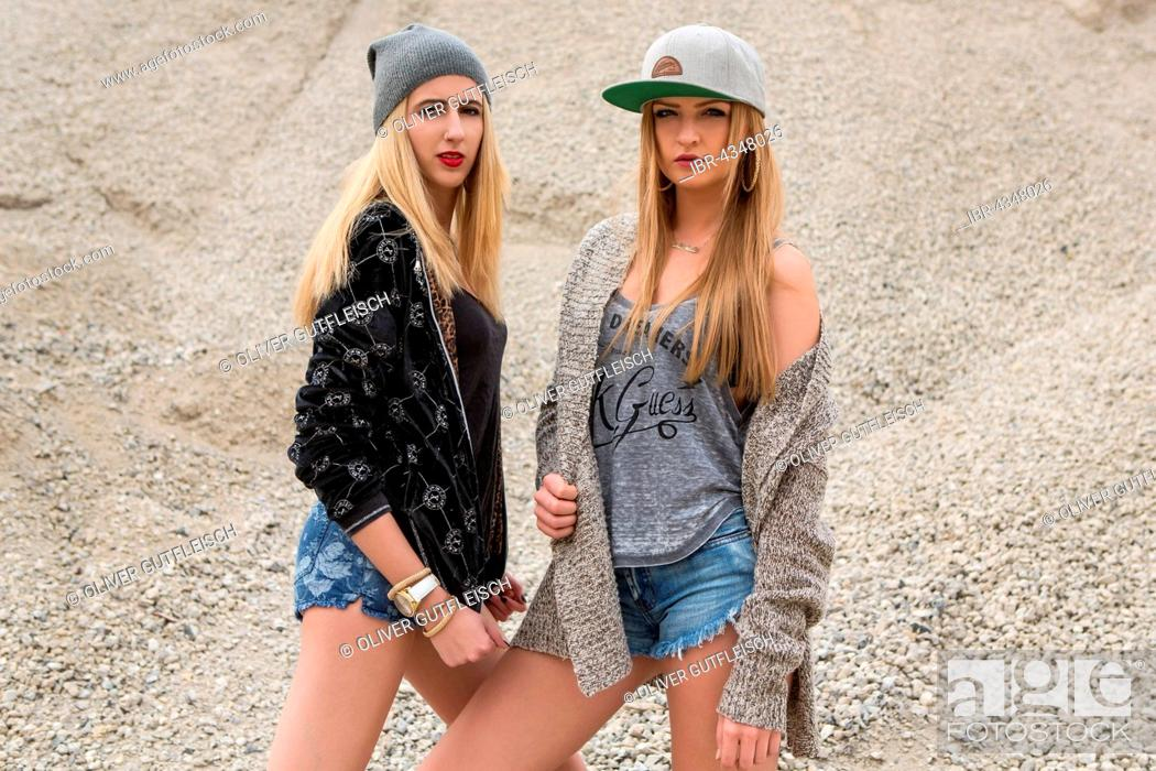 Stock Photo: Two young women posing in leisure look, fashion.