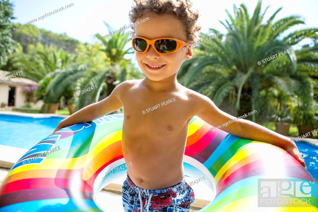 Stock Photo: Young boy enjoys summer.