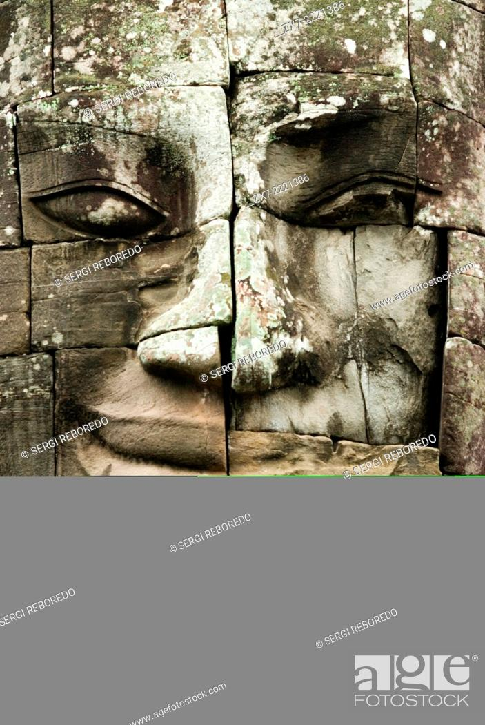 Stock Photo: The faces of the Bayon temple. Angkor Thom. Angkor Thom was built as a square, the sides of which run exactly north to south and east to west.