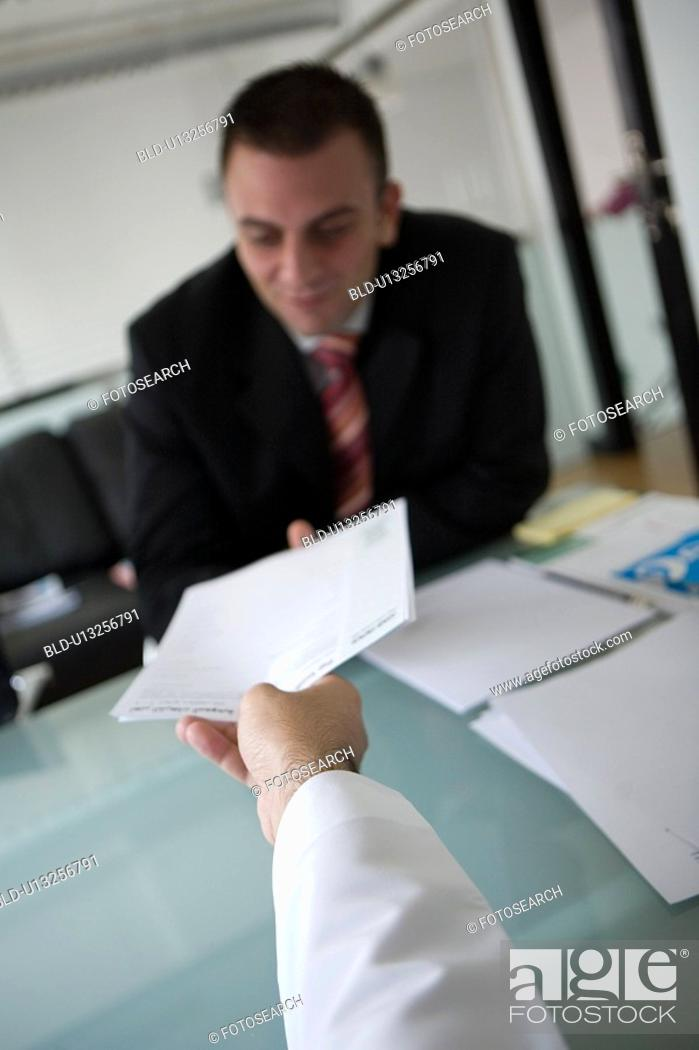 Stock Photo: document, business, handing, businessmen, businessman, Arabic.