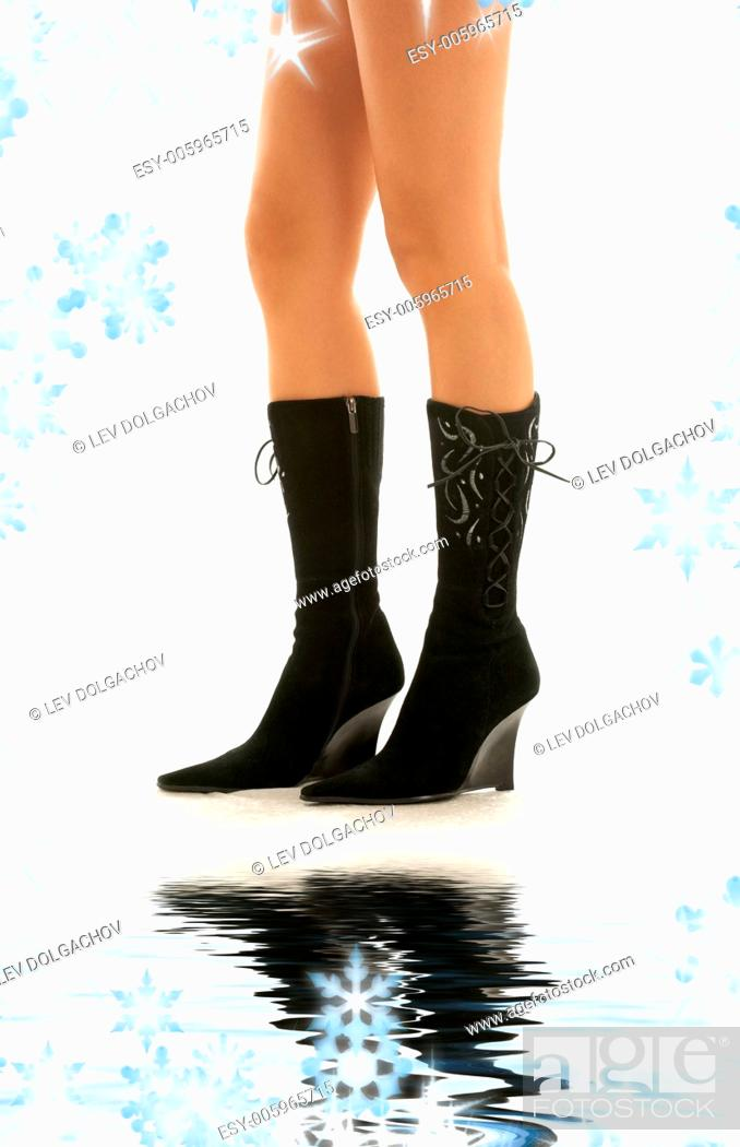 Stock Photo: picture of perfect legs in black boots.