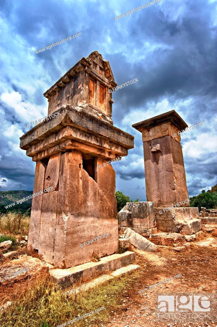 "Stock Photo: The Lycian """"Harpy Tomb"""", a marble pillar tomb from 480-470 B.C. The the Greek Archaic style carvings of four winged female figures."