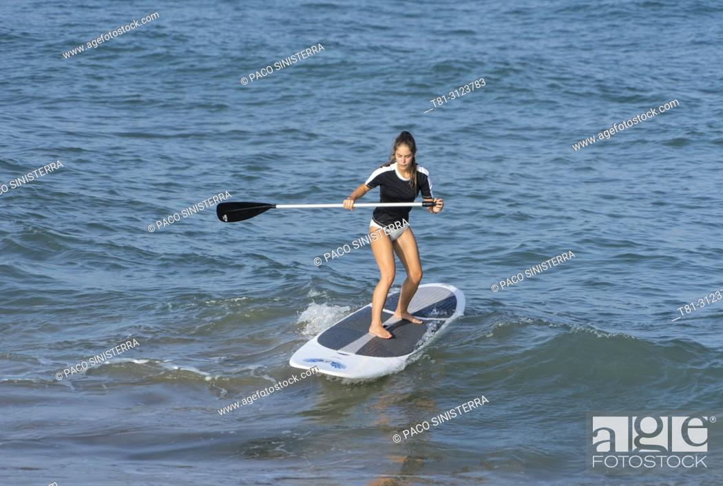 Stock Photo: girl doing paddle surfing, Alcocebre, Castellon, Spain.