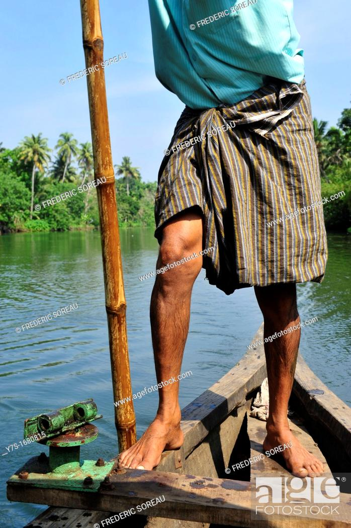 Stock Photo: Indian boatman with bamboo pole rowing ,close-up,Kerala backwaters,Kerala,South India,Asia.