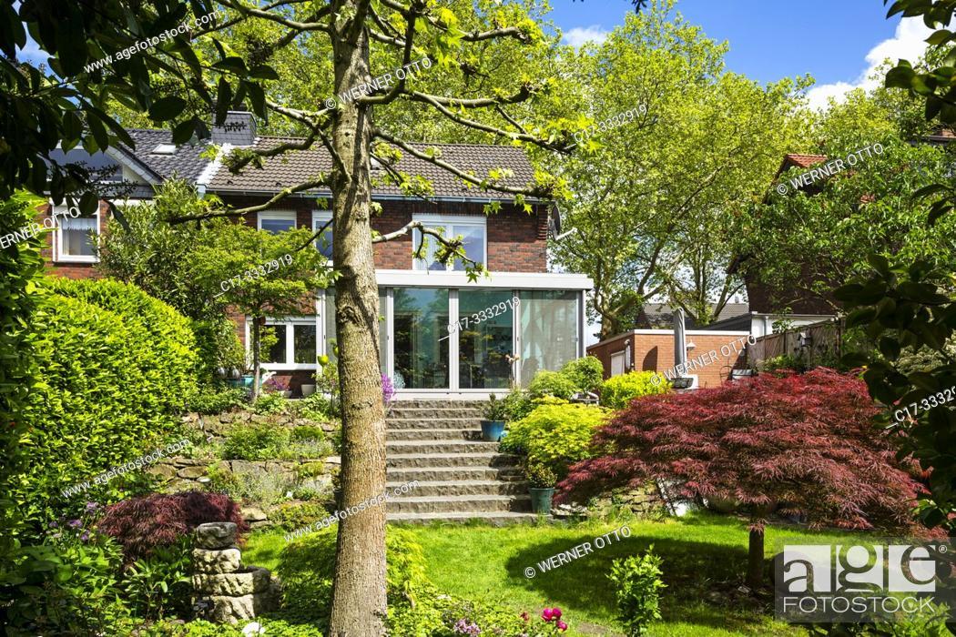 Stock Photo: Oberhausen, Sterkrade, residential house with winter garden, single-family home, row house, garden side, flower garden, rock garden, rockery, outside staircase.