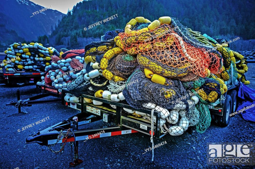 Stock Photo: Piled up seiner fishing nets on trailers parked outside Silver Bay Seafood, Gary Paxton Industrial Park near Sitka, Alaska, USA.