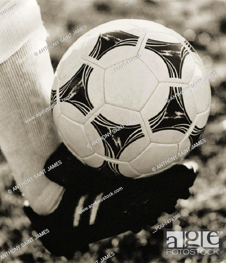 Stock Photo: Kicking Soccer Ball.