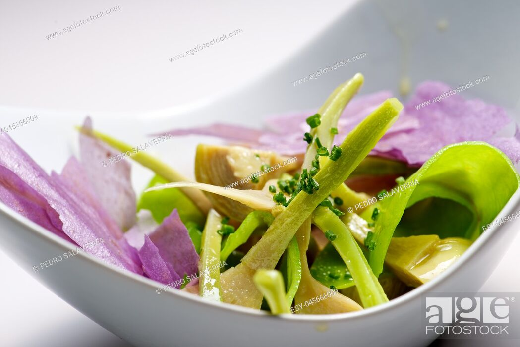 Stock Photo: Artichoke salad and blue potato with vegetables.