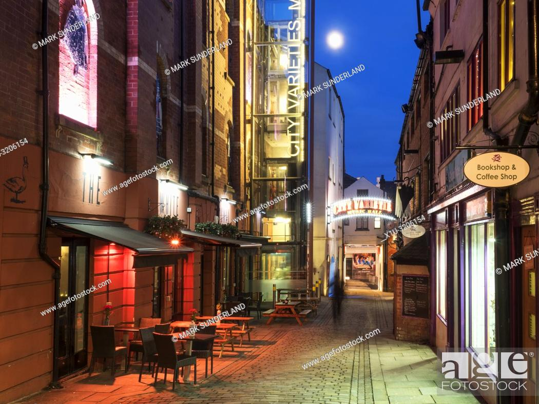 Stock Photo: City Varieties restored 19th century music hall at dusk on Swan Street in Leeds West Yorkshire England.