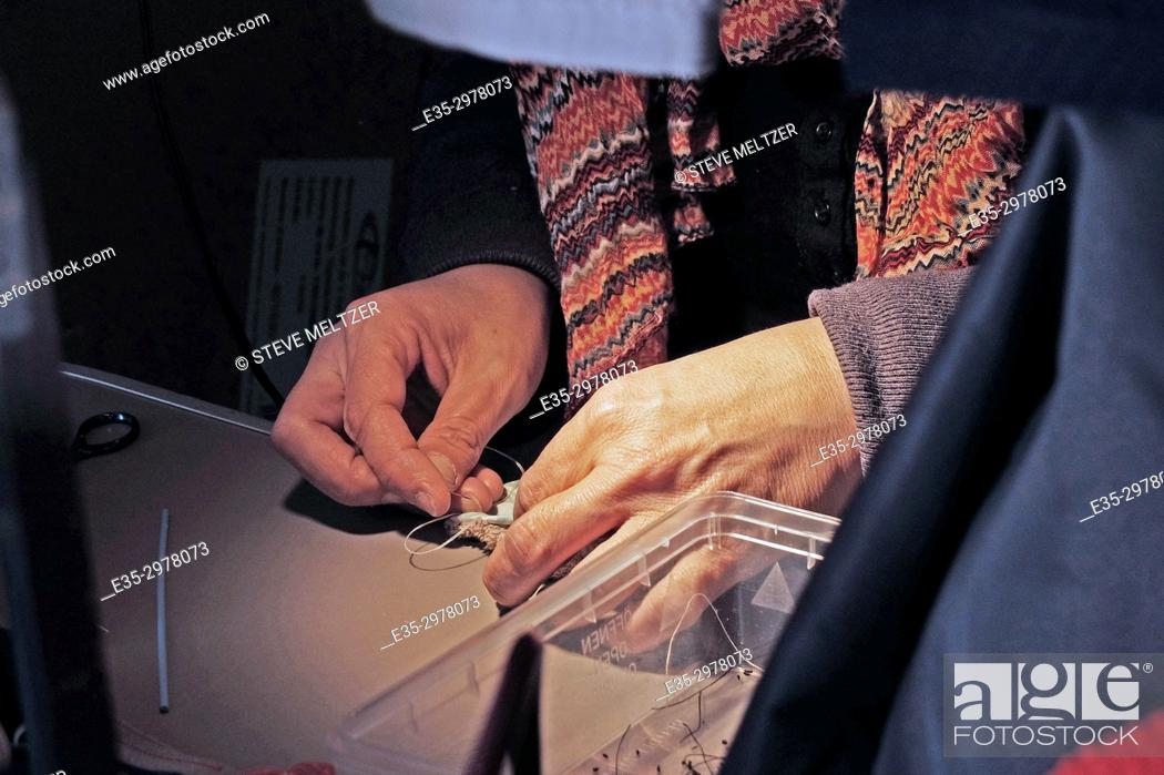 Stock Photo: Sewing a handmade fabric purse.