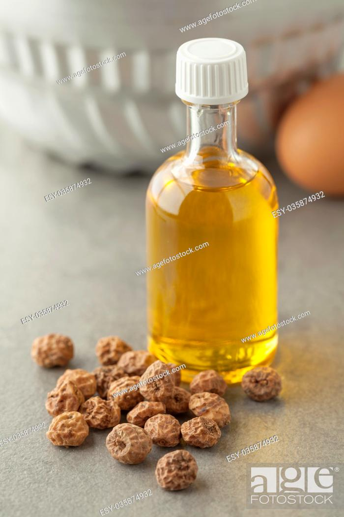 Photo de stock: Bottle with Chufa oil and nuts.