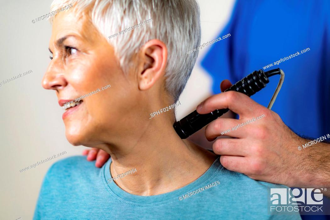 Stock Photo: Physiotherapy laser treatment.