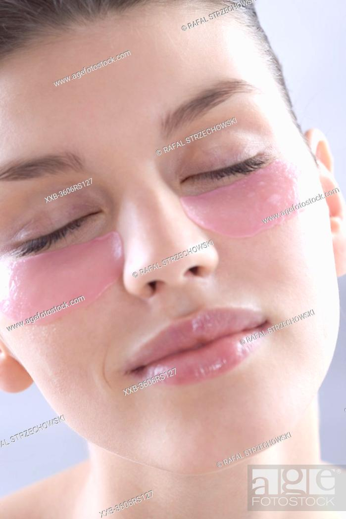Stock Photo: young woman with eye mask.