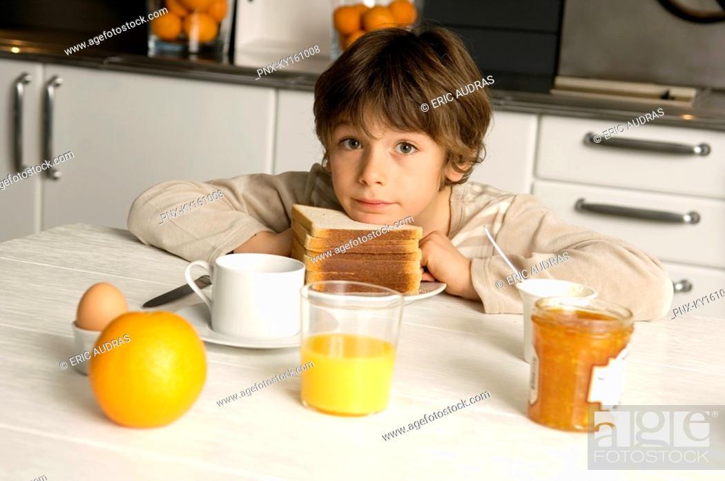Stock Photo: Portrait of a boy having breakfast.