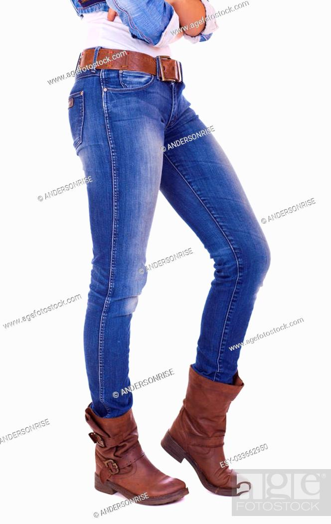 Stock Photo: Front view of a standing woman model wearing denim with boots isolated on a white background.