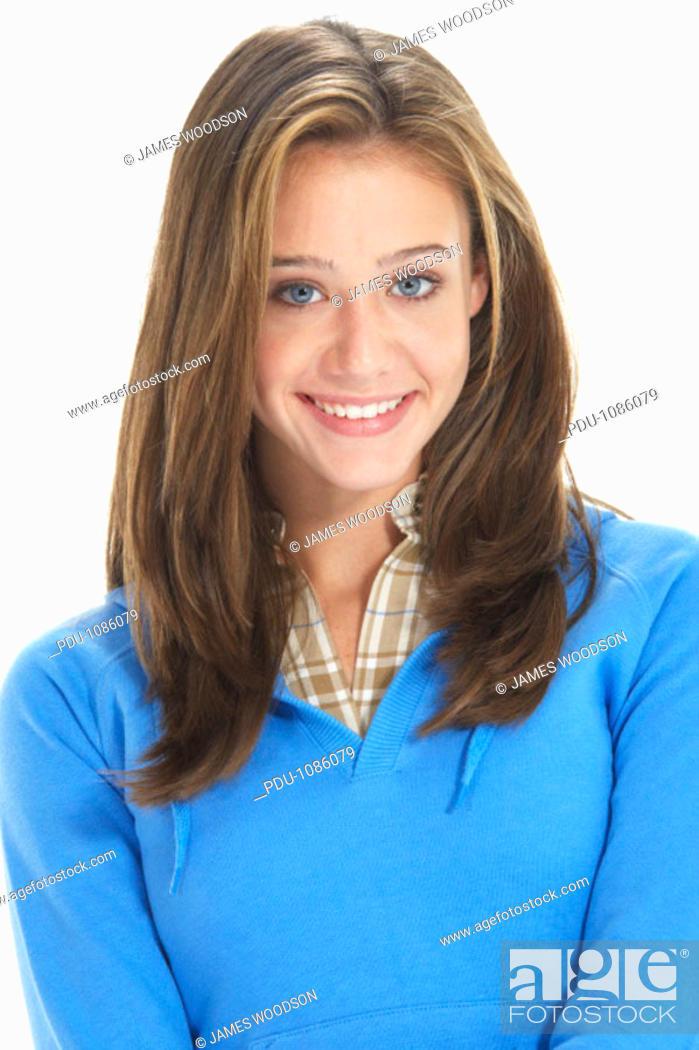 Stock Photo: Teenage girl (14-16) against white background, smiling, portrait.