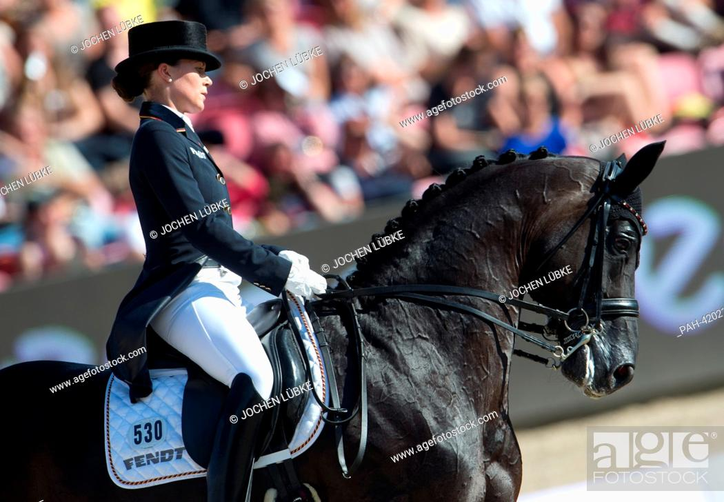 Dressage Rider Kristina Sprehe From Germany Waves After Performing Her Skills With Horse Desperados Stock Photo Picture And Rights Managed Image Pic Pah 42021503 Agefotostock