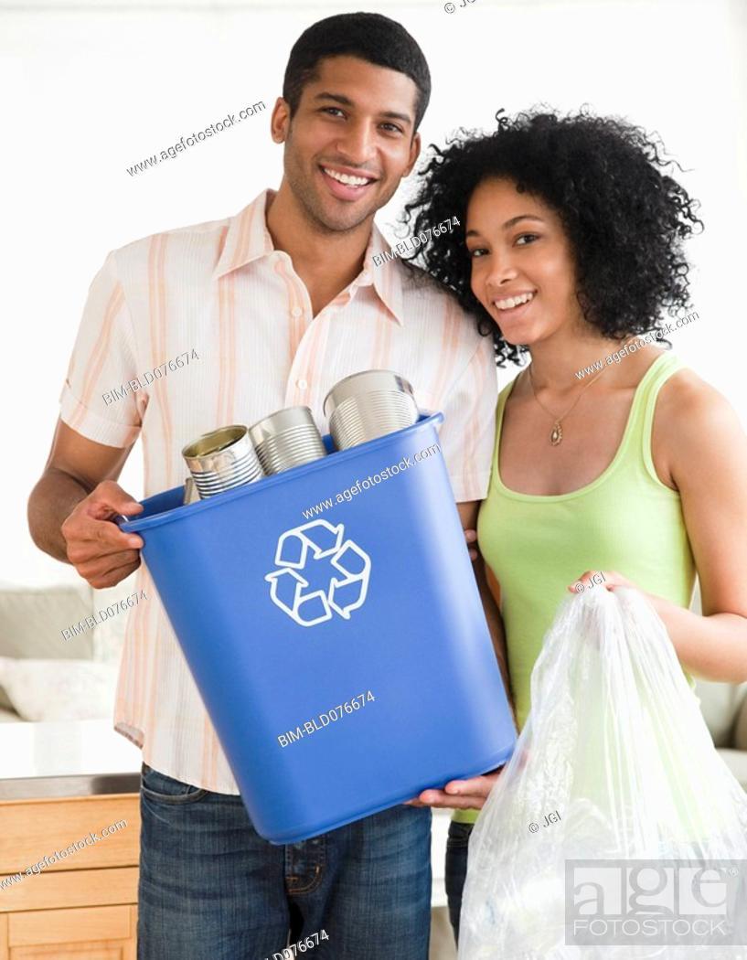 Stock Photo: Couple recycling.