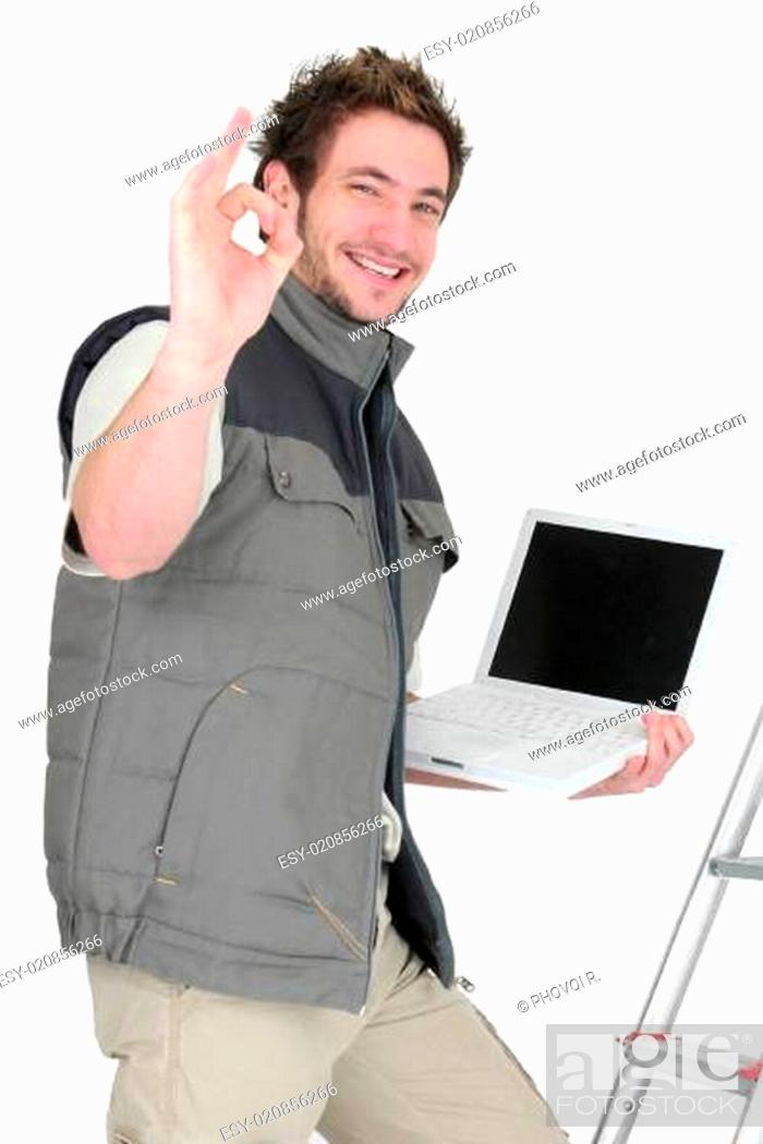 Stock Photo: OK from a tiler with a laptop.