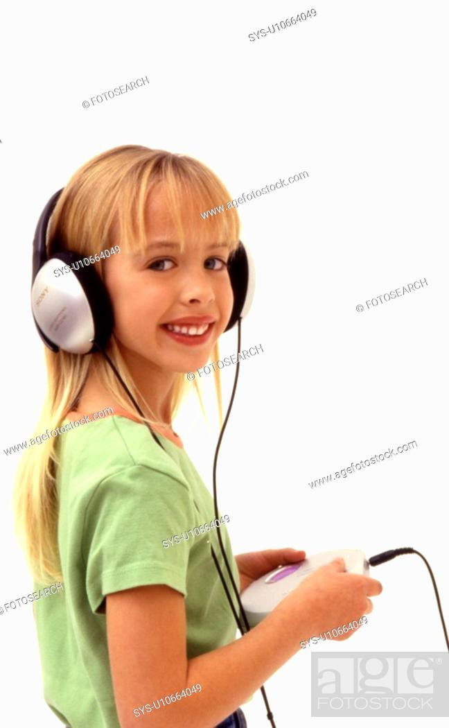 Stock Photo: Young girl wearing large ear phones.