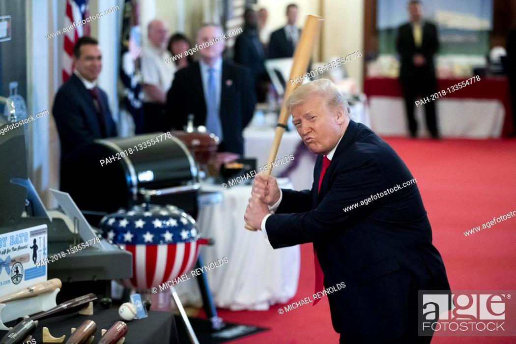 Stock Photo: US President Donald J. Trump swings a baseball bat while participating in the 'Spirit of America Showcase', at the White House in Washington, DC, USA.