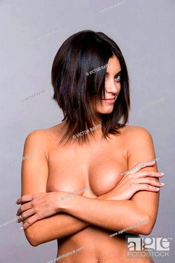 Mature women smiling nude Close Up Of A Naked Young Woman Standing With Her Arms Crossed And Smiling Stock Photo Picture And Royalty Free Image Pic Ssd 1799r 5157 Agefotostock