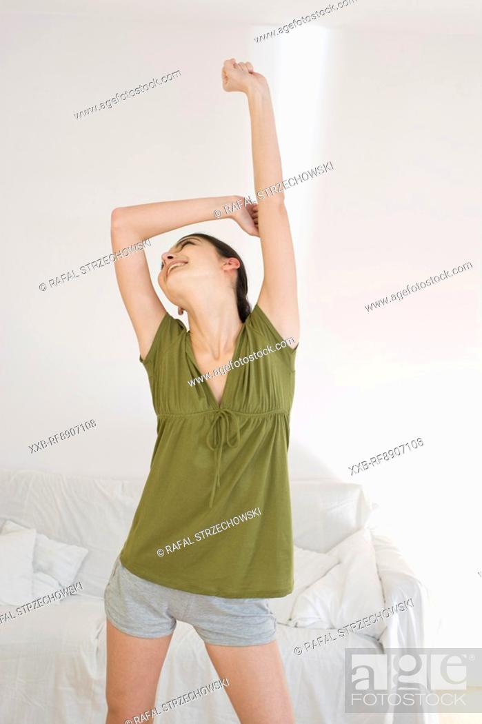 Stock Photo: happy young woman.