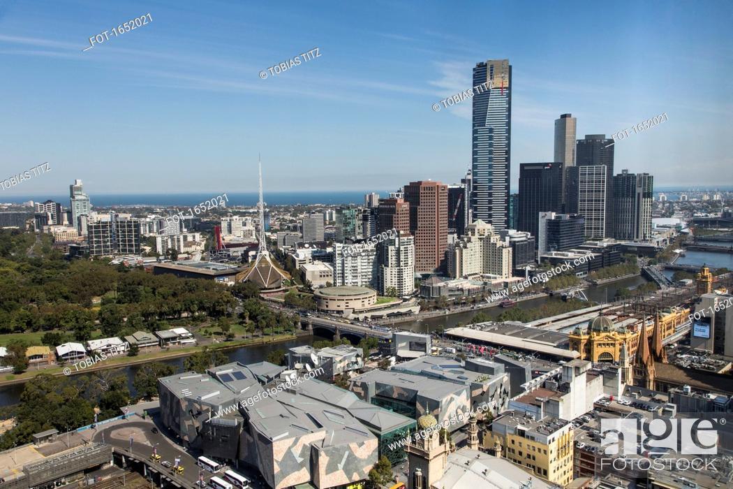 Stock Photo: Aerial view of cityscape against sky and sea, Melbourne, Victoria, Australia.