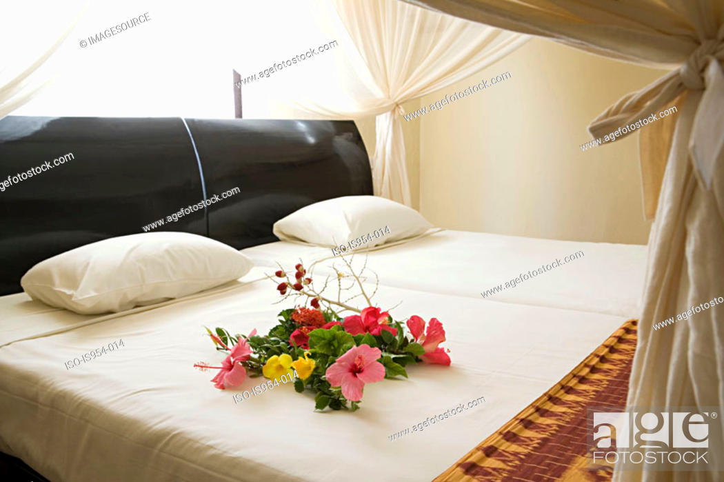 Stock Photo: Flowers on bed.