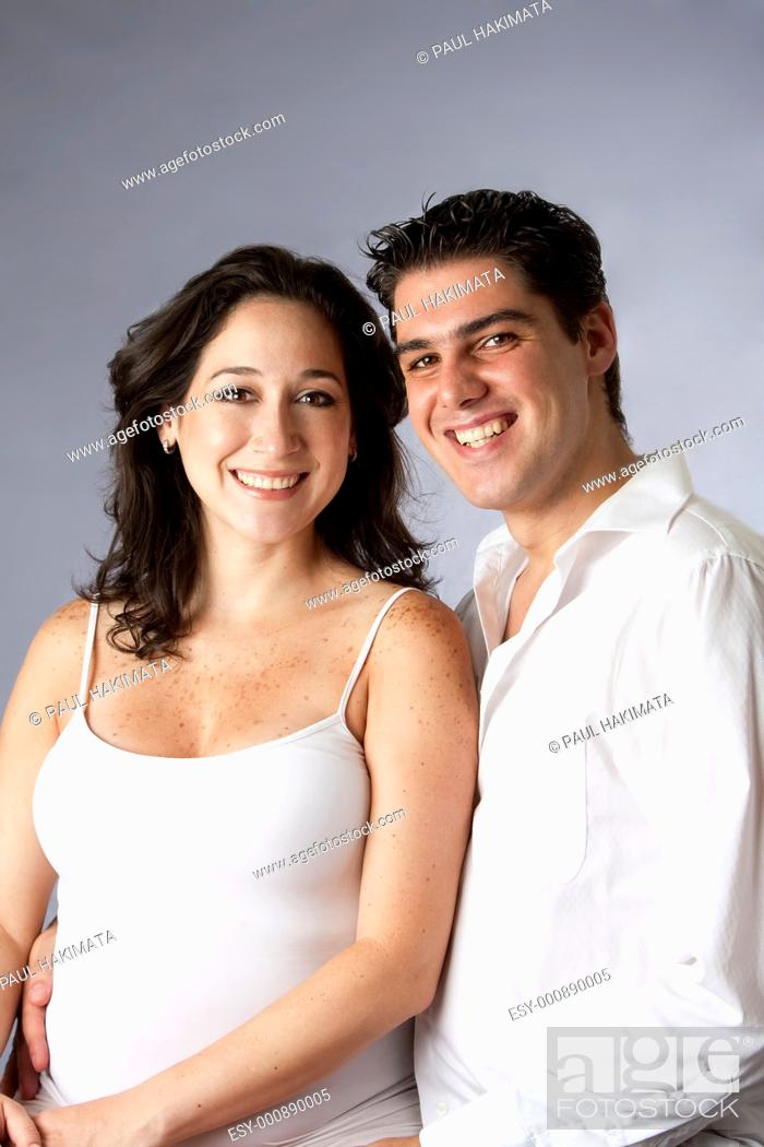 Stock Photo: Portrait of a beautiful happy young couple smiling dressed in white, isolated.