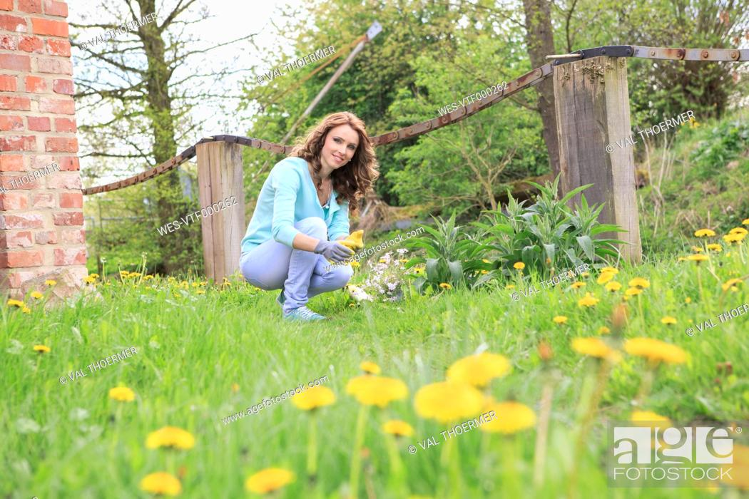 Stock Photo: Young woman working in the garden.
